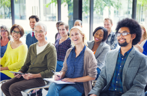 group sitting through benefits presentation