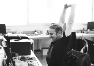 stretching and other tips for improving health and wellness at work